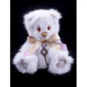 Игрушка из натурального меха кролика с розовым бантиком