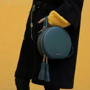 Женская сумка с кисточками зеленая